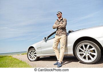 happy man near cabriolet car outdoors - road trip, travel,...