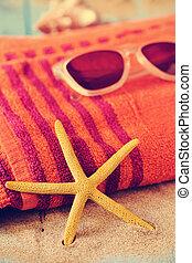 starfish, sunglasses and beach towel