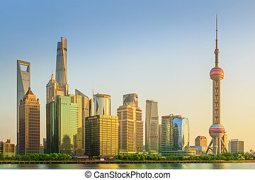 Cityscape of Shanghai and Huangpu River on sunset, beautiful...