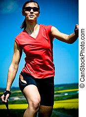 nordic walking - a young woman making nordic walking....