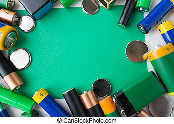close up of green alkaline batteries - recycling, energy,...