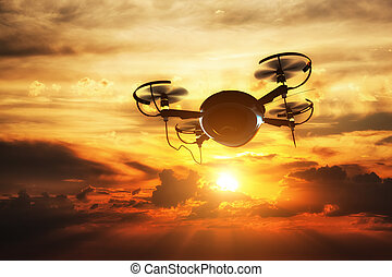 Drone flying at sunset. Sun shining on dramatic sky. 3D...