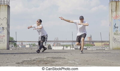 Hiphop dancers on the rooftop - Video of active young couple...