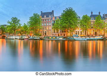 Panoramic view and cityscape of Amsterdam with boats, old...