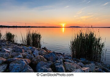 sunet over lake - beautiful sunset in the Danube Delta,...