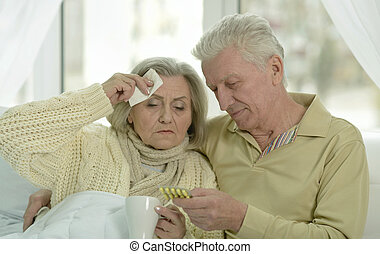 sick  senior woman with her husband