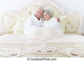 Senior couple in bed - Portrait of a happy senior couple in...