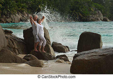 elderly couple rest at tropical beach - Happy elderly couple...