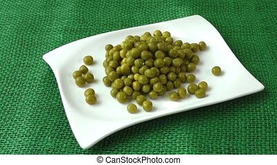 Green peas on a white plate