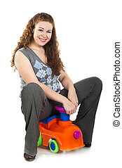 Young happy beautiful woman playing toy.