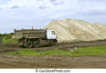 Large truck running in the quarry for the extraction of sand