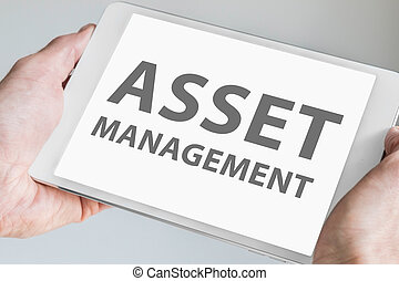 Asset management text on tablet - Asset management text...