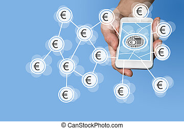 Mobile e-payment and e-commerce concept with hand holding...