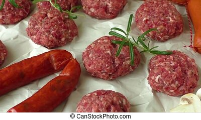 Raw minced hamburger meat with herb and spice prepared for...