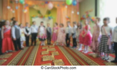 Children singing songs in the hall of the nursery - Children...