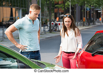 Couple Looking At Car Collision - Worried Young People...