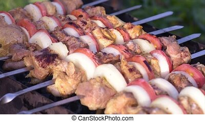Barbecue with delicious grilled meat on grill Pork meat...