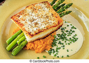 Halibut Filet with Asparagus and Sweet Potatoes - Close up...