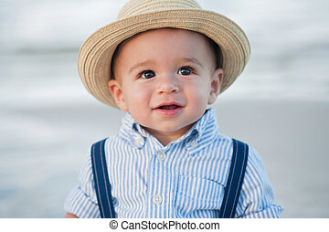 One Year Old Baby Boy with Straw Fedora Hat - A headshot of...