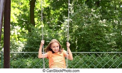 Girl on chain swings