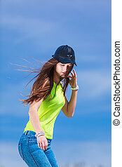 Teenage girl on blue sky background Female with long brown...