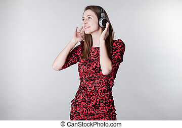 the girl listens to music with headphones