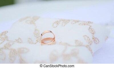 Golden wedding rings on white background.