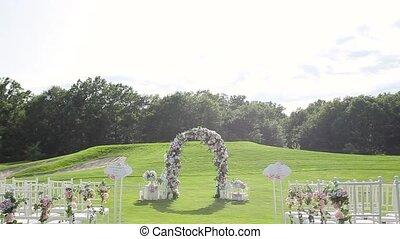 Wedding altar on a green lawn.