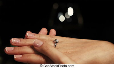 Man holding hands woman with engagement ring with diamond on finger. Proposal.