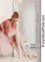Ballerina dress pointes - Pretty young ballerina puts on...