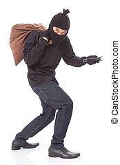 Thief with bag and holding flashlight, isolated on white...