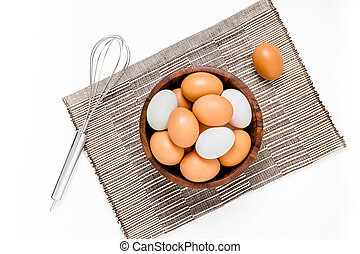 top view of eggs in bowl on white backgrond
