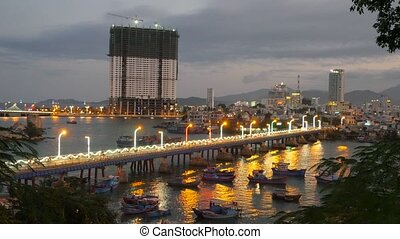 Traffic of many motorcycle in a night bridge. City bay with...
