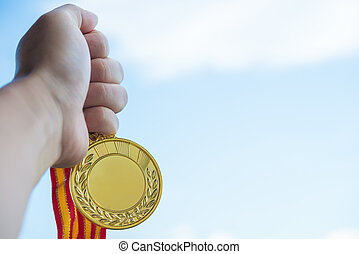 holding a gold medal