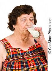 Elderly woman drinking milk