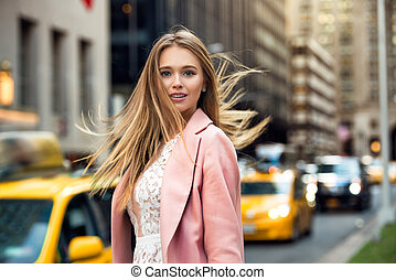 blonde with flyaway hair - Portrait of the blonde woman with...