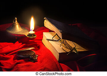 Under the light of oil lamps