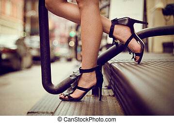 woman legs in high heel shoes outdo