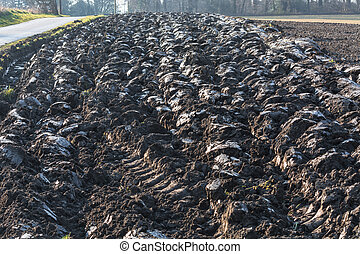 Plowed field with furrows - Freshly plowed field with...