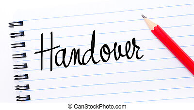 Handover written on notebook page with red pencil on the...