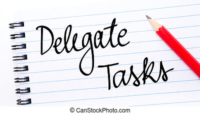 Delegate Tasks written on notebook page with red pencil on...