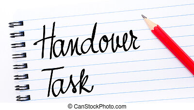 Handover Task written on notebook page with red pencil on...