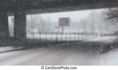 Bus getting under the bridge during snowfall - Commuting to...