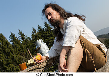 eremite making a healthy snack in the nature - a eremite...