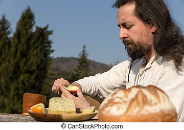 bearded and long-haired man making a light meal - bearded...