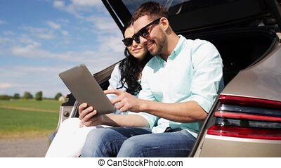 happy couple with tablet pc at hatchback car trunk 19 -...
