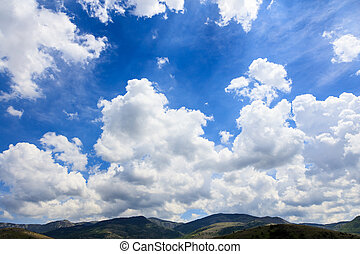 Scenic rural background with blue sky and white fluffy...