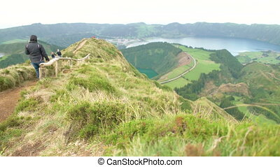 Couple Walking on the Sete Cidades - Adult couple walking...