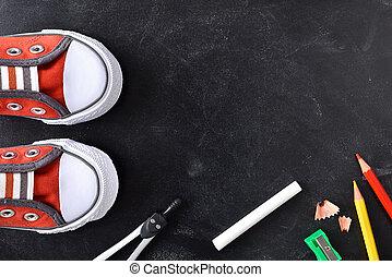 School supplies around a blackboard - School supplies and...