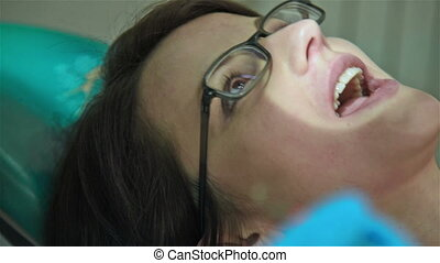 Dentist Examines Teeth - Woman Having Teeth Examined At...